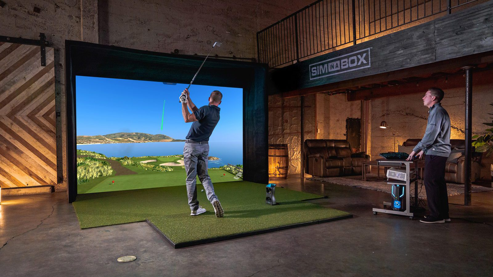 Golfer swings club indoors using the foresight performance analysis technology while expert looks on