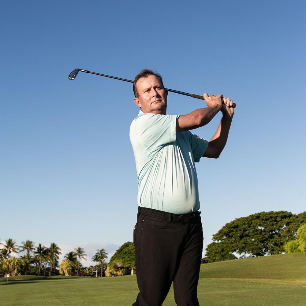 Golf pro Brendan Moynahan swinging golf club