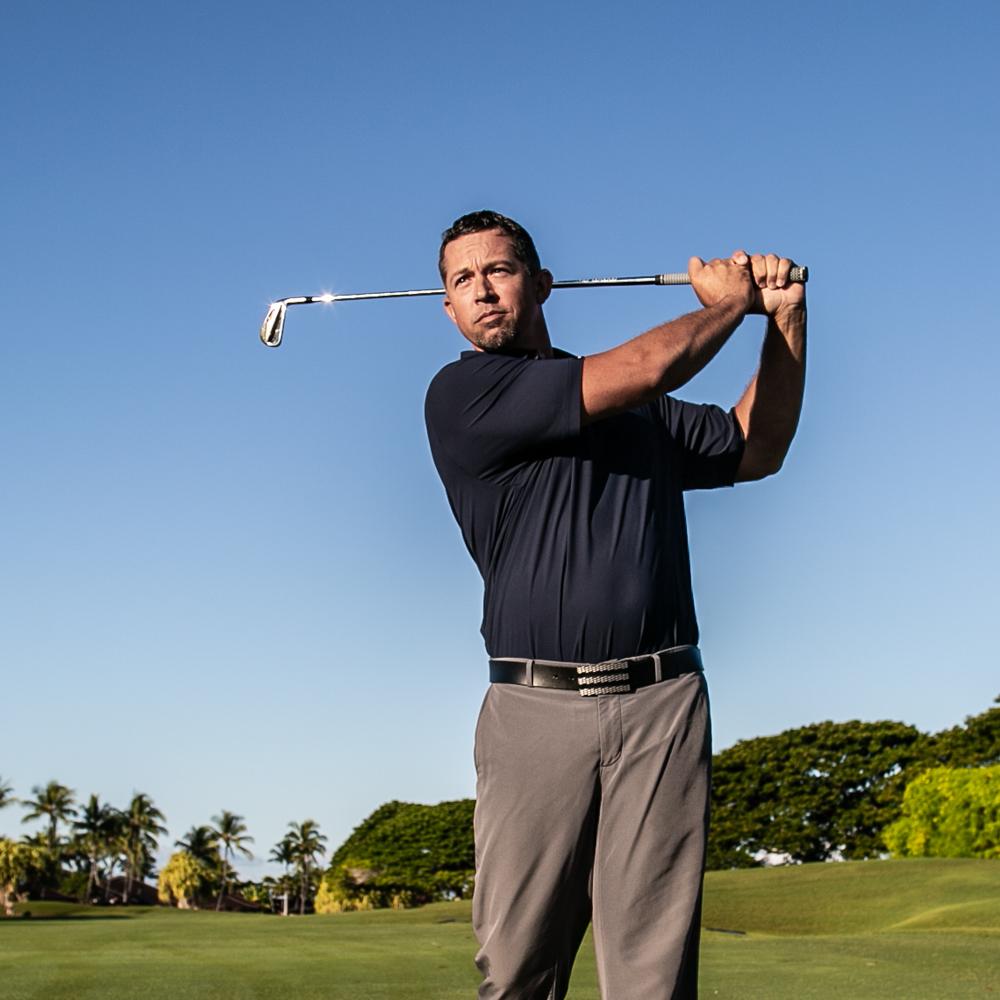 Golf pro Jake Beveal swinging golf club