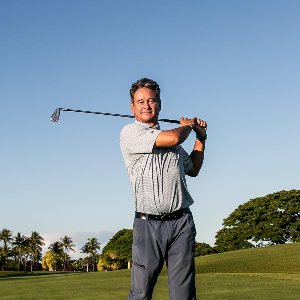 Golf pro Matt Hasegawa swinging golf club